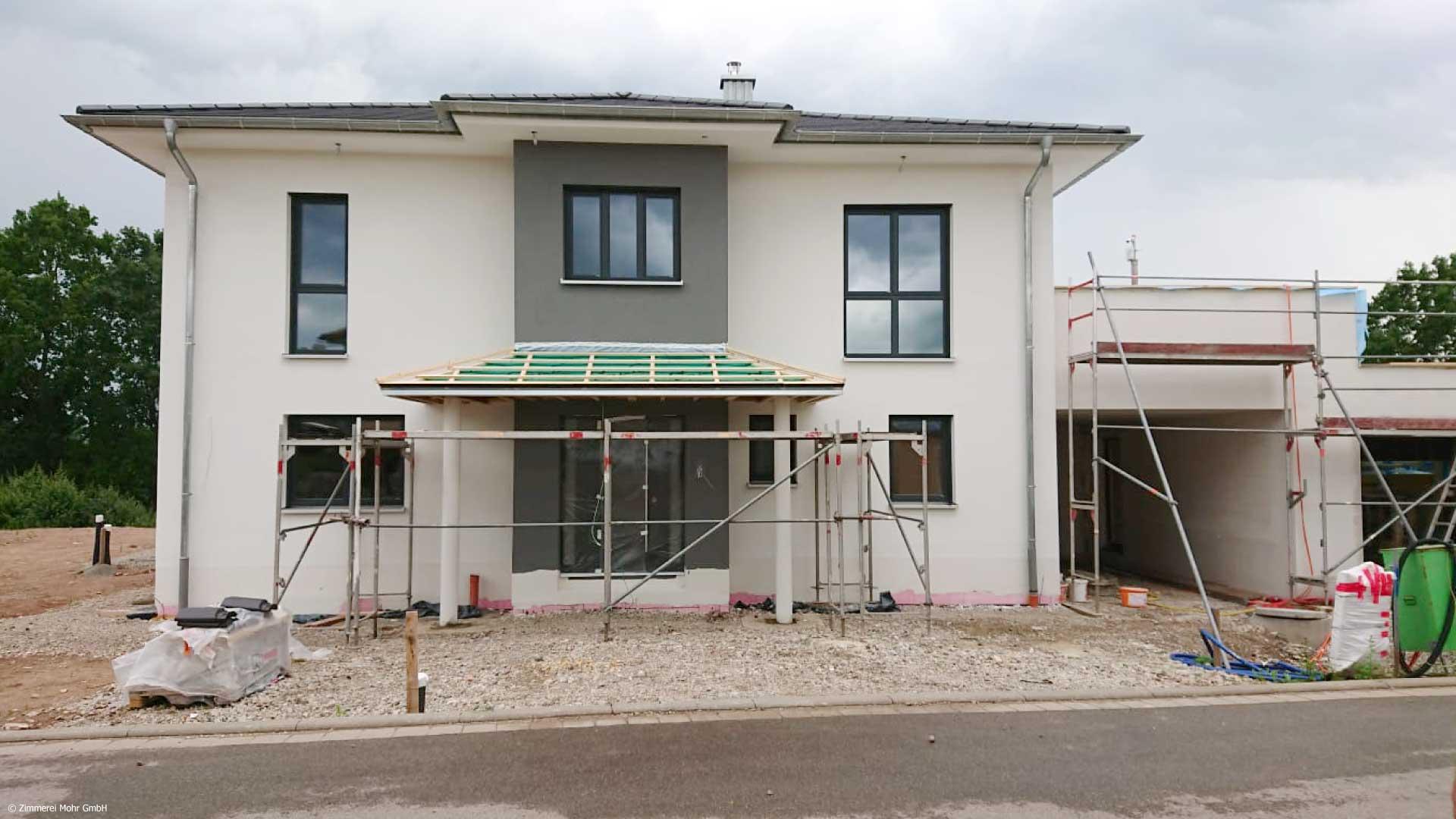Stadtvilla FELICE – Neubau Holzhaus mit Walmdach